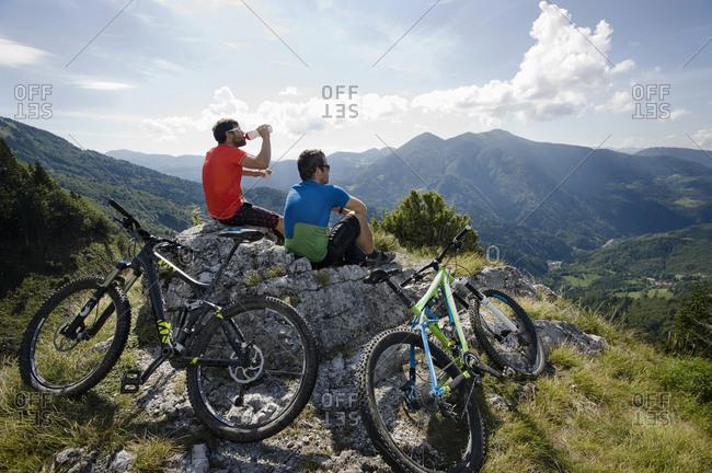 Two mountain biker having a rest, Slatnik, Istria, Slovenia
