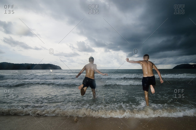 Two boys at ocean, Lankawi, Malaysia