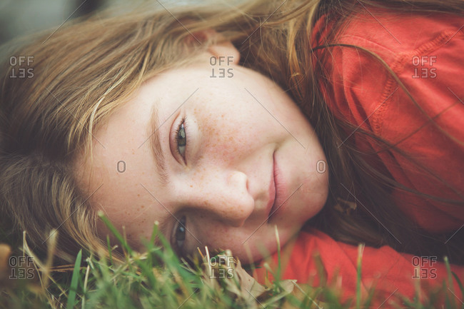 Portrait of a girl lying in the grass