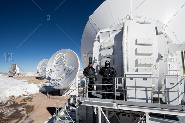 Santiago, Chile - July 10 2013: Two male workers at the Atacama Large Millimeter/submillimeter Array (ALMA), Chajnantor Plateau, Atacama, Chile
