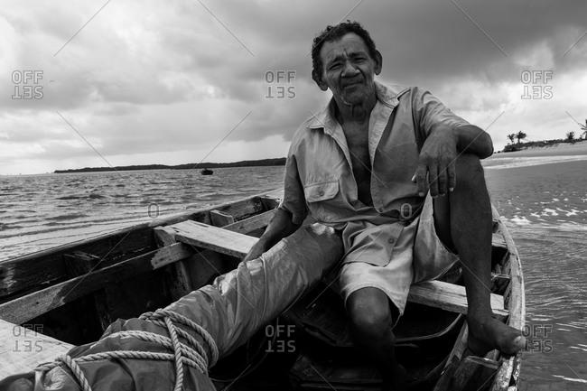Atins, Maranhao, Brazil - May 6, 2014: Fisherman sitting on a boat