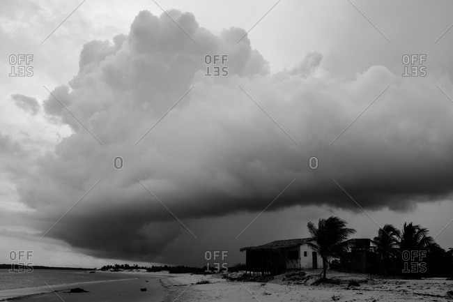 House on the beach and storm