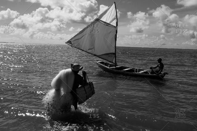 Fisherman walking to his boat