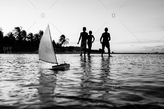 Children playing with toy boat