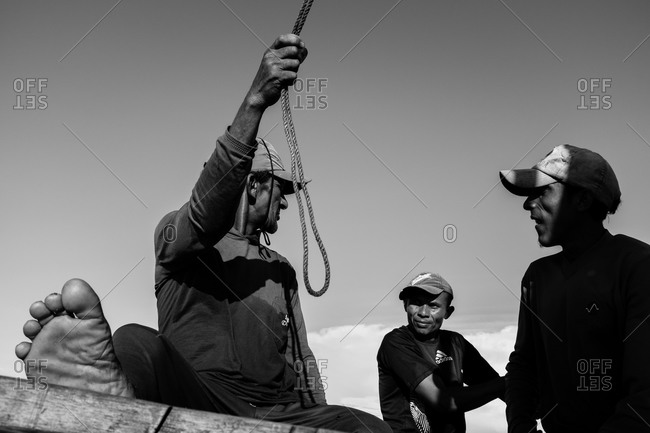Atins, Maranhao, Brazil - May 6, 2014: Three men on a sail boat
