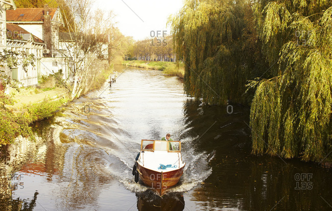 Amsterdam, The Netherlands - November 4, 2011: A boat going up a canal