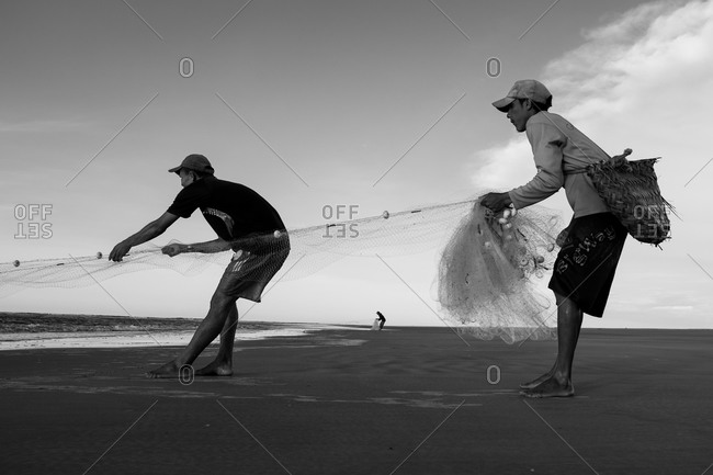 Atins, Maranhao, Brazil - May 6, 2014: Three men Fishing