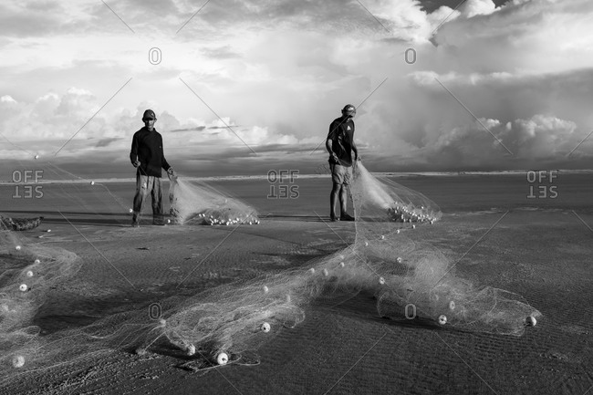 Atins, Maranhao, Brazil - May 6, 2014: Two men fishing