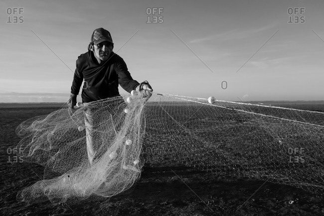 Atins, Maranhao, Brazil - May 6, 2014: Fisherman pulling fishnet