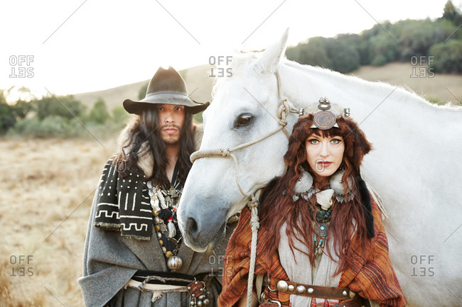 Couple posing by a horse