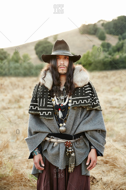 Portrait of man wearing Native-American clothing