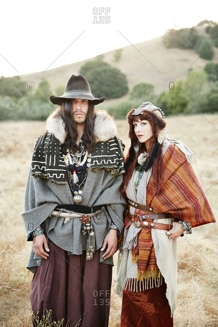 Nomadic couple posing in a field
