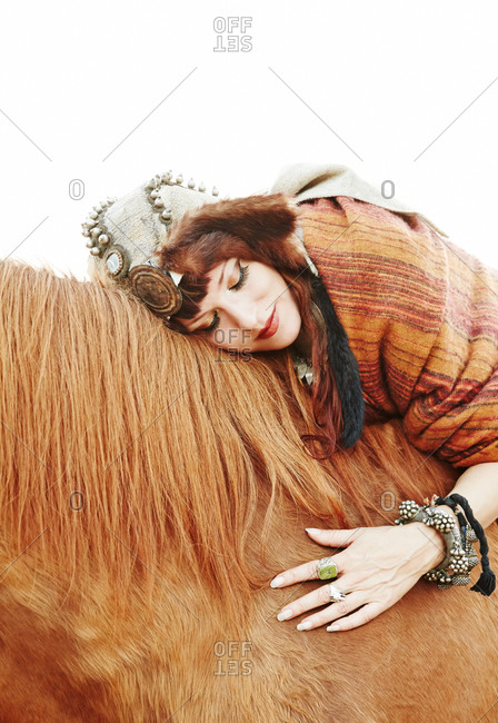 Woman hugging her horse