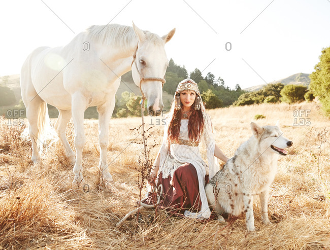 Woman posing with animals