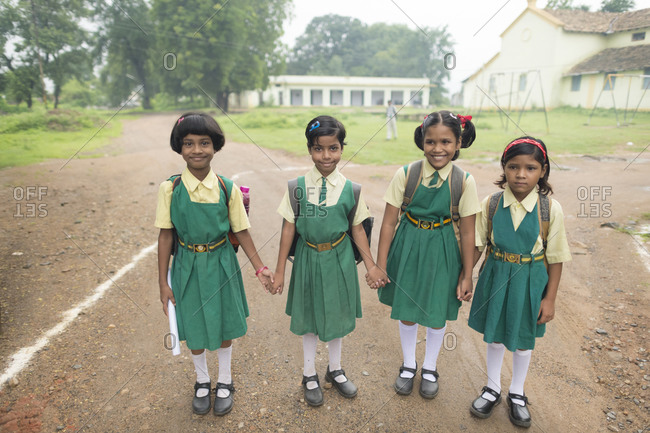 India - July 29, 2014: Girls holding hands in a schoolyard
