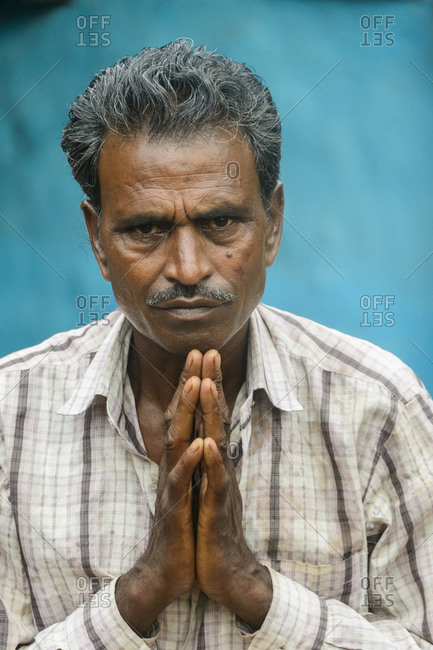 India - July 31, 2014: Man greeting with a namaste