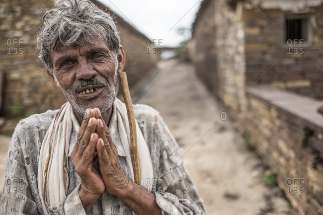 India - August 1, 2014: Man welcomes guest with namaste in a village