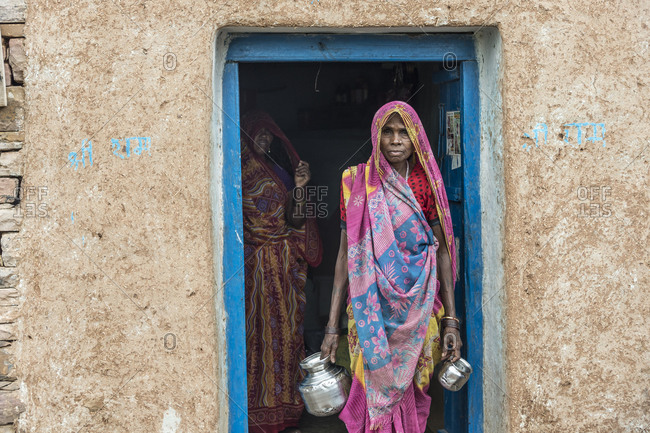 India - August 1, 2014: An Indian woman prepares to walk to a well for water