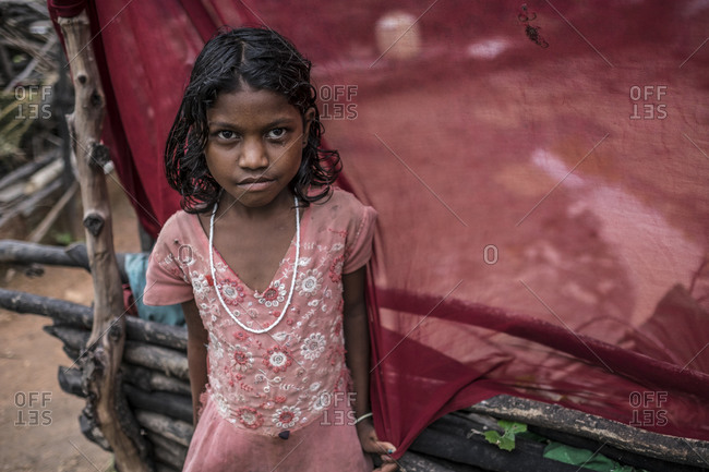 Central India - August 1, 2014: Young girl holding school supplies