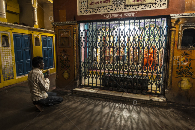 Central India - August 1, 2014: A devotee prays at a Hindu temple