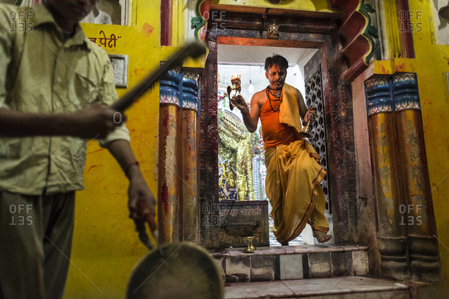Central India - August 1, 2014: A pujari performing the puja rituals