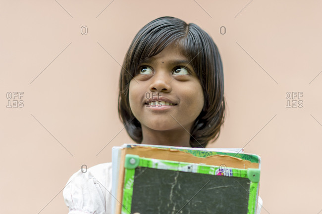 Central India - August 1, 2014: Young school girl in rural Central India