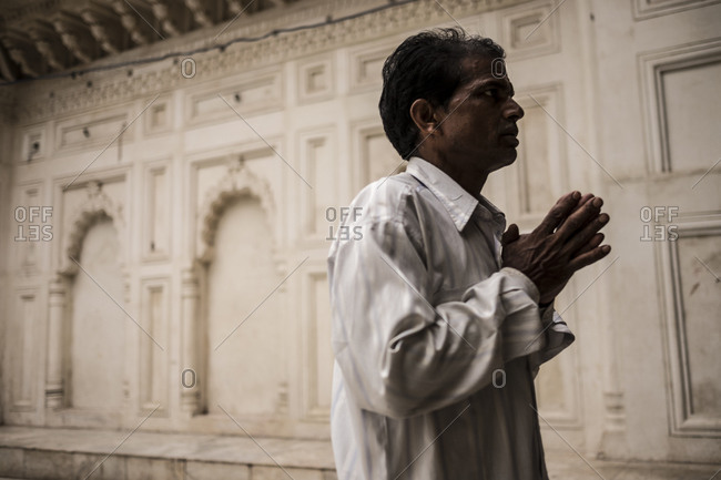 Central India - August 2, 2014: Man praying at a Hindu temple