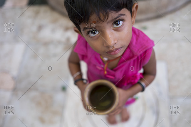 Central India - August 2, 2014: Young girl offering her water sacrifice to Shiva