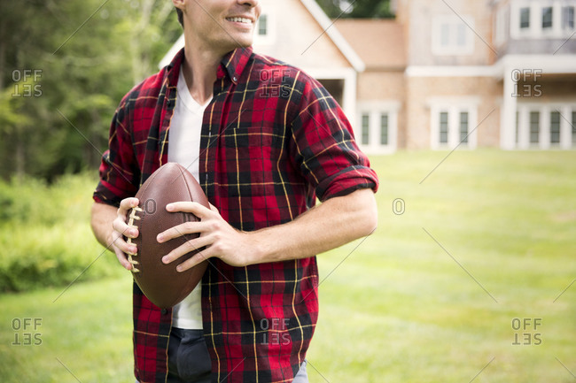 Man standing with American football