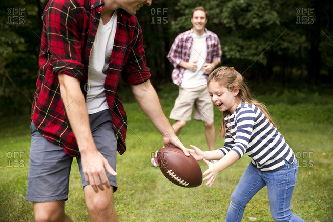 Man playing American football with a girl