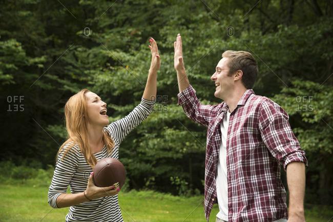 Couple playing American football