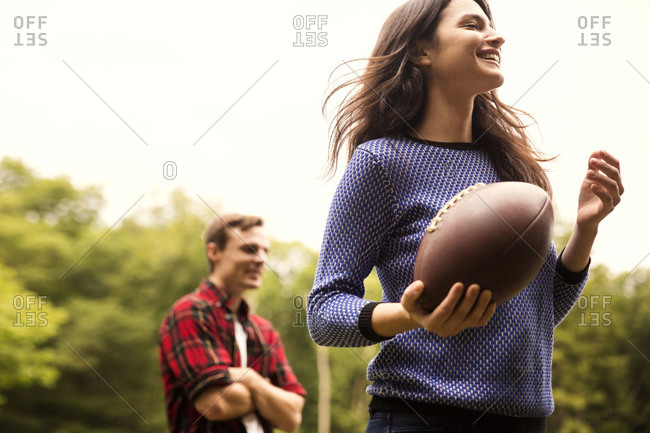 Low angle view of a woman with American football