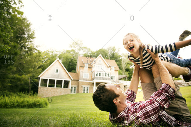 Father and daughter playing in a park