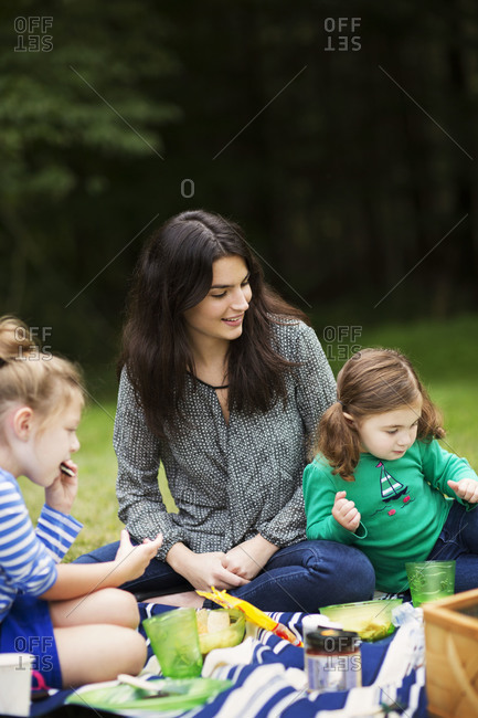 Mother with her daughters on a picnic