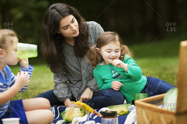 Mother and daughters having a picnic