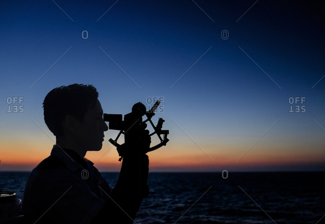 Man looking through sextant, Barcelona, Spain