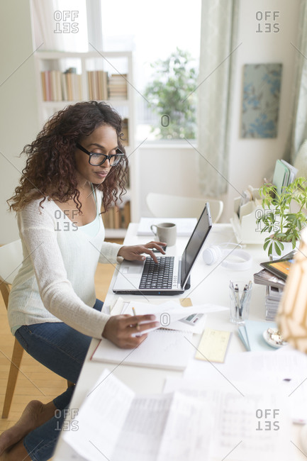 Woman paying bills via internet