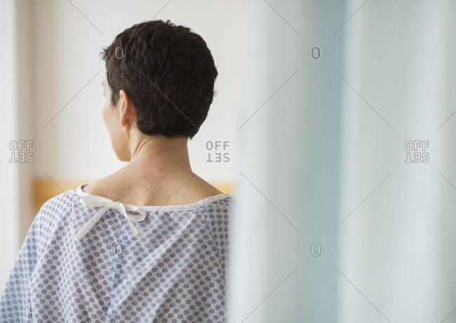 Rear view of senior woman wearing hospital gown