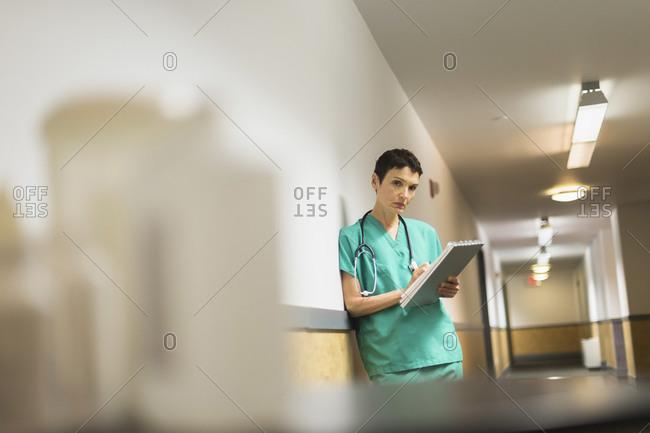Female doctor in hospital corridor