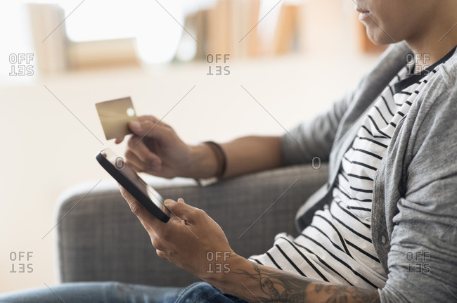 Man paying with credit card on tablet