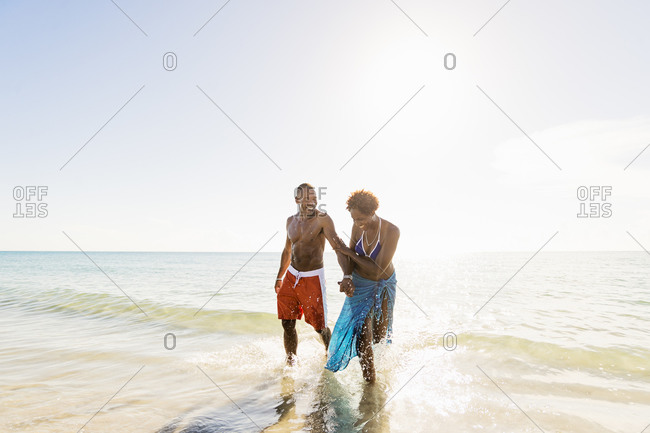 Mature couple walking in sea