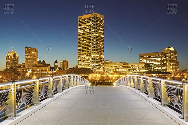 Pedestrian bridge with skyline in background, Milwaukee
