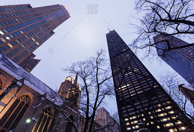 Low angle view of John Hancock Center seen from Fourth Presbyterian Church