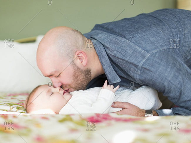 Studio shot of father kissing his son (2-5 months)