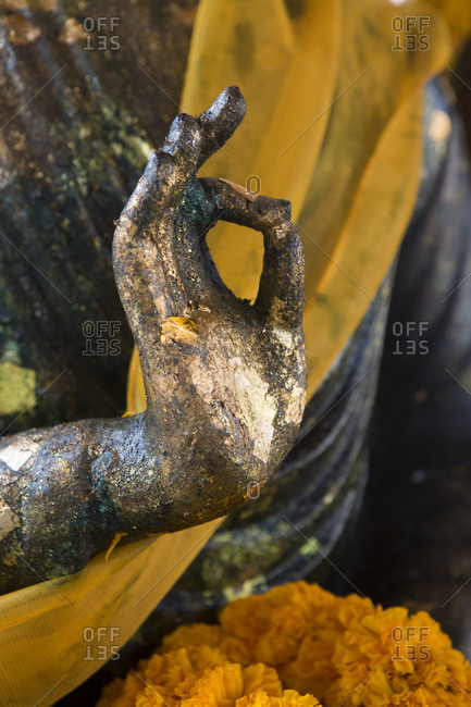 Close-up of hand of ancient statue of the Buddha