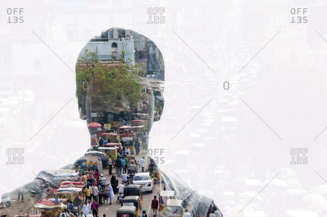 Silhouette of man through which can be seen a South Asian street
