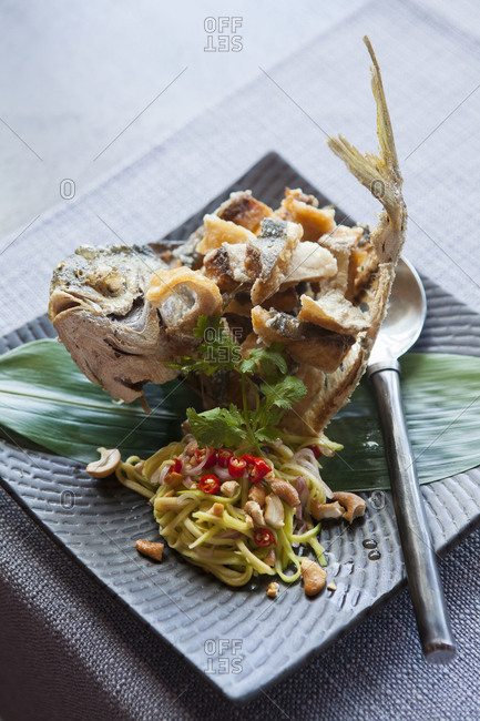 Fish dish served on a banana leaf