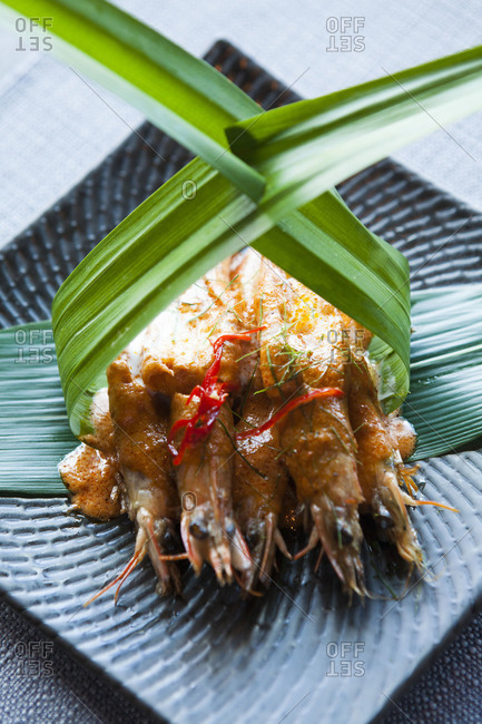Fried shrimp served in banana leaves