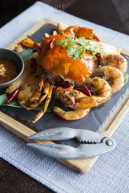 Crab dish served on a banana leaf