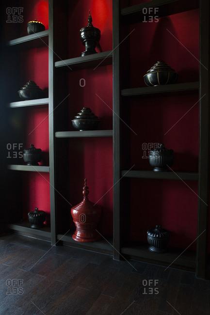 Shelf of various Japanese teapots